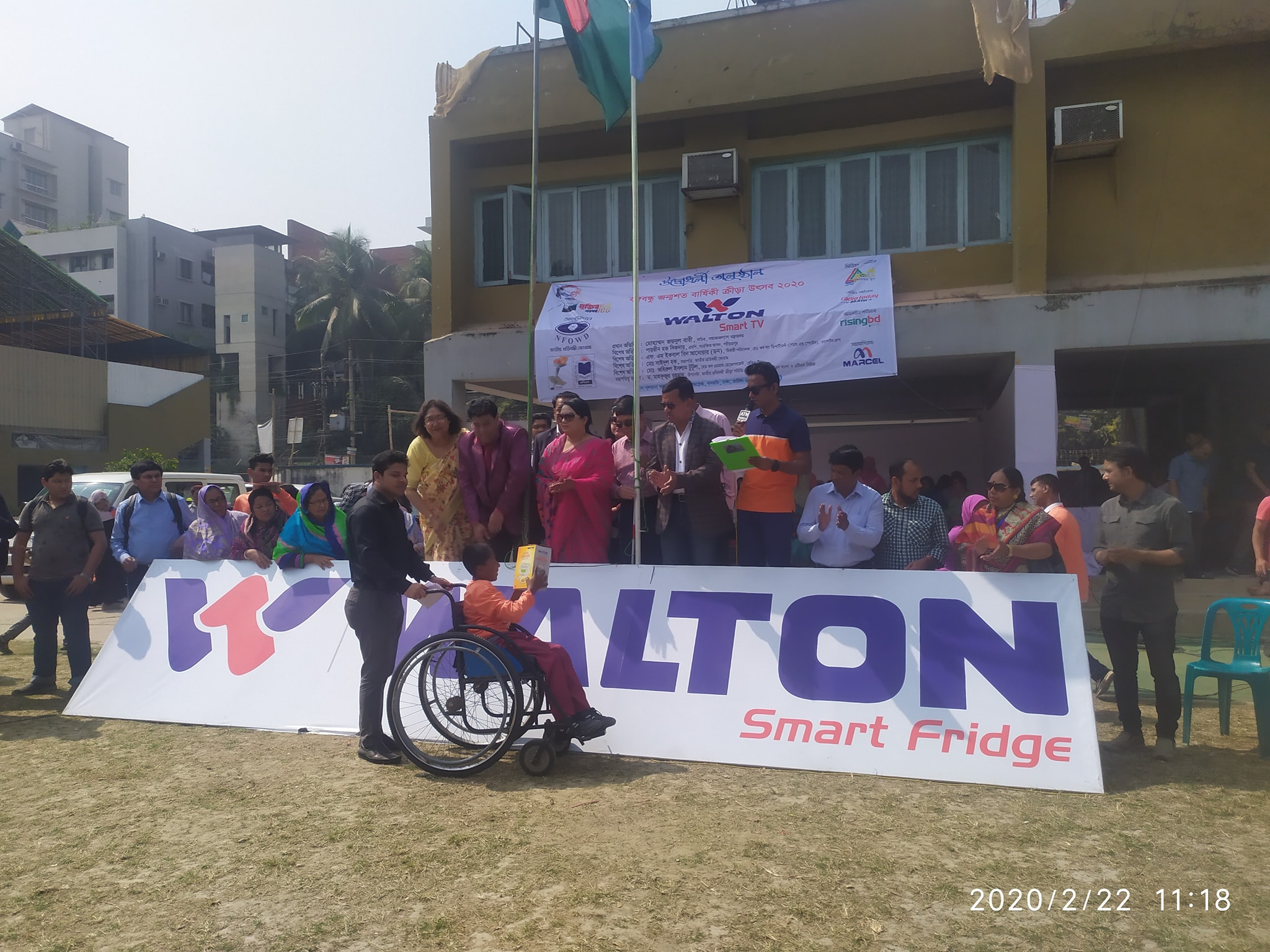 A children with physical disability receiving prize of wheelchair race