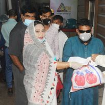 Secretary General of NFOWD Dr. Salina Akhter distributing relief during covid19 20220